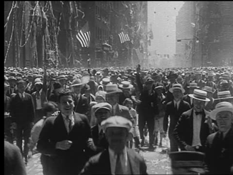 car point of view crowd running on street toward camera during parade for charles lindbergh - anno 1927 video stock e b–roll