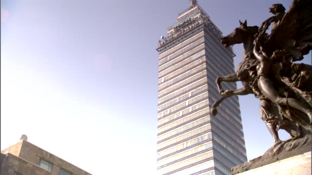 torre latinoamericana bg pegasus statue of frame outside palacio de bellas artes opera house - pegasus stock videos & royalty-free footage