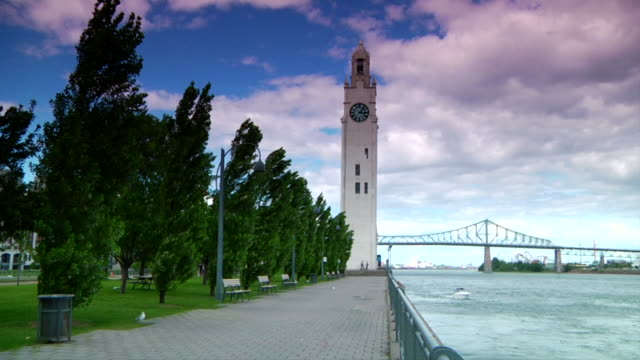 Tour de l'Horloge AKA Sailors' Memorial Tower on Clock Pier/Victoria Pier along St Lawrence River w/ waterfront treelined walkway w/ Jacques Cartier...