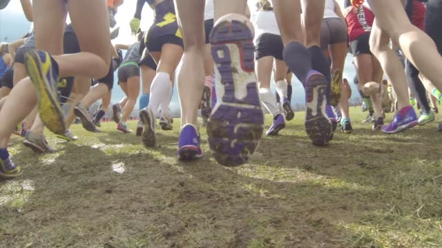 RUNNERS CHARGE OUT AFTER HORN SOUNDS CROSS COUNTRY RACE START