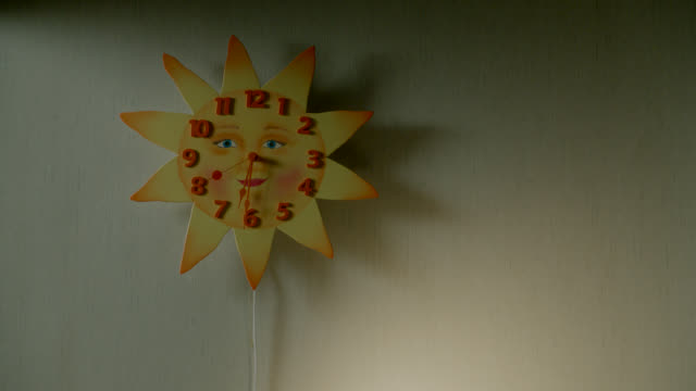 close angle of sun-shaped clock. - wand stock-videos und b-roll-filmmaterial