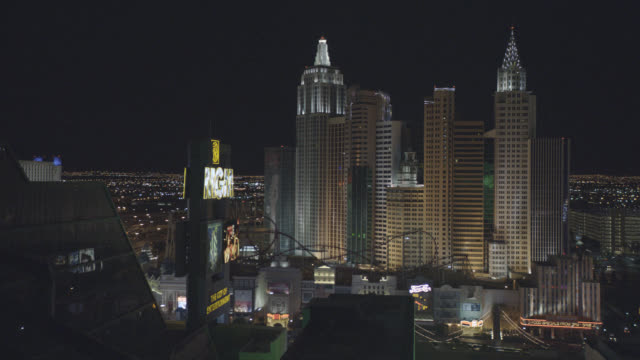 MEDIUM ANGLE OF LAS VEGAS STRIP. MGM GRAND CASINO AND HOTEL SIGN IN FG. NEW YORK NEW YORK HOTEL AND CASINO VISIBLE IN BG. CITY SKYLINES