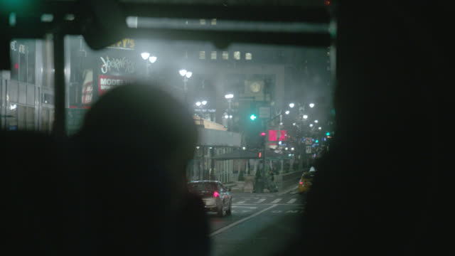 wide angle driving pov from bus of city streets. commercial area, stores and shops. avenue of the americas, greely square and 33rd. - beifahrersitz oder rücksitz stock-videos und b-roll-filmmaterial