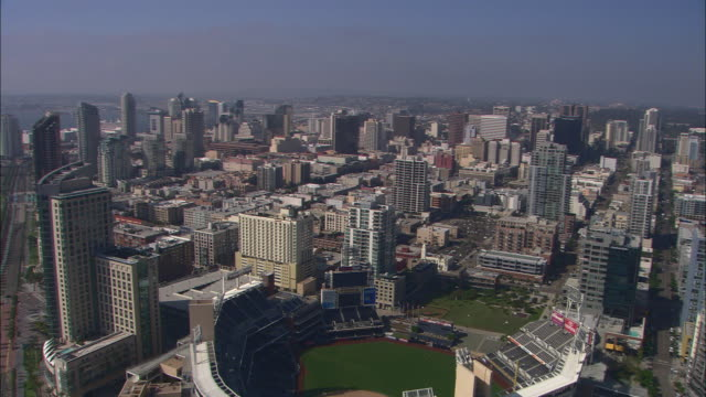 AERIAL OF DOWNTOWN SAN DIEGO CITY SKYLINE. SKYSCRAPERS AND HIGH RISE OFFICE OR APARTMENT BUILDINGS. BASEBALL STADIUM.