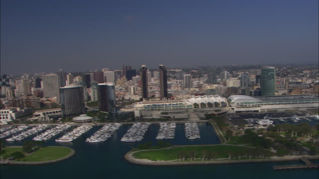 AERIAL OF SAN DIEGO CITY SKYLINE. BOATS IN MARINA. CONVENTION CENTER.