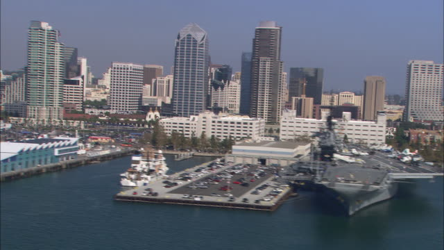 AERIAL OF SAN DIEGO CITY SKYLINE. HIGH RISE OFFICE AND APARTMENT BUILDINGS. CARNIVAL CRUISE SHIP.