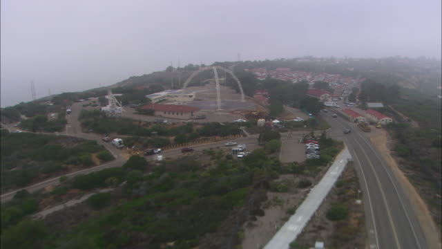 AERIAL OF POINT LOMA NAVY BASE. CLOUDY AND OVERCAST.