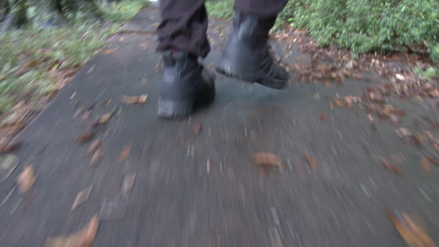 close angle of police officer's or swat team's boots running. - human limb stock videos & royalty-free footage