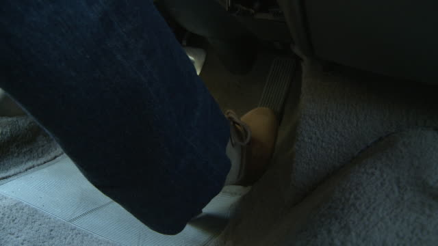 CLOSE ANGLE OF FOOT STEPPING ON GAS AND BRAKE PEDAL WHILE DRIVING CAR. SERIES.