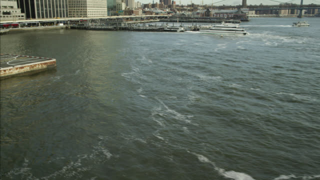 aerial of new york city waterfront. city skyline and high rises visible. - ヘリポート点の映像素材/bロール