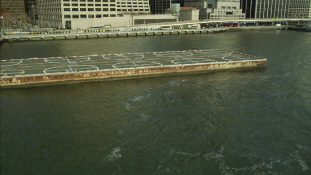 vídeos de stock, filmes e b-roll de aerial of new york waterfront and helipad. - helicopter landing pads