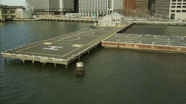 AERIAL OF HELICOPTER ON HELIPAD ON NEW YORK WATERFRONT.