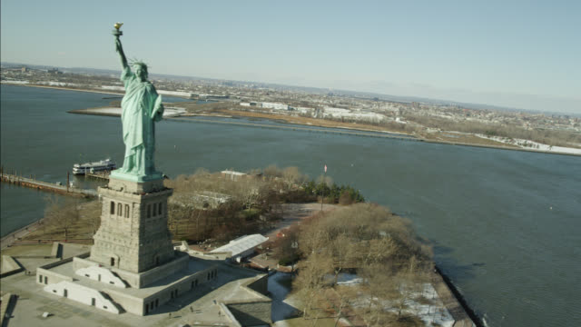 AERIAL OF STATUE OF LIBERTY IN NEW YORK HARBOR.