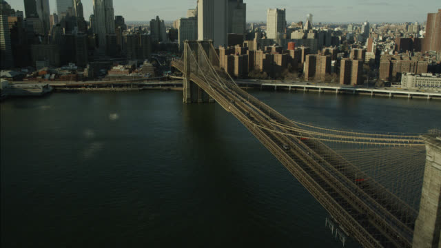 AERIAL OF BROOKLYN BRIDGE AND EAST RIVER.