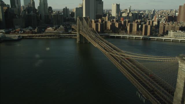 aerial of brooklyn bridge and east river. - brooklyn bridge stock-videos und b-roll-filmmaterial