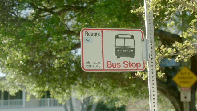 CLOSE ANGLE OF SIGN FOR BUS STOP.