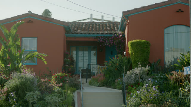 medium angle of spanish style ranch house. - ranch house stock videos & royalty-free footage