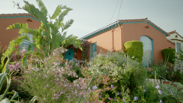 medium angle of spanish style ranch house. - spanish culture stock videos & royalty-free footage