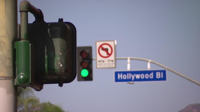 MEDIUM ANGLE OF STREET SIGN FOR HOLLYWOOD BOULEVARD.