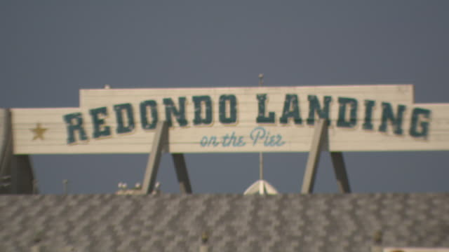 vidéos et rushes de medium angle of sign for redondo landing. restaurant. - fondu d'ouverture