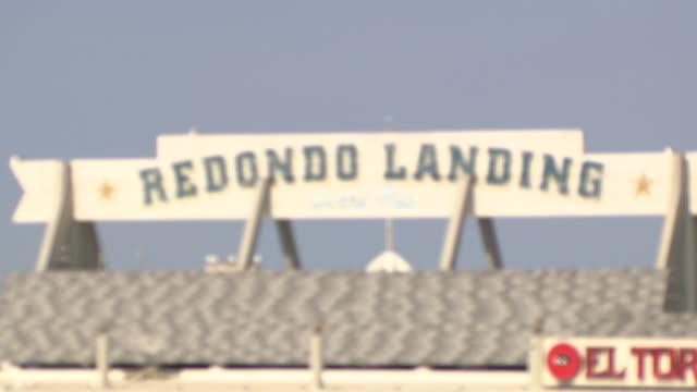 MEDIUM ANGLE OF SIGN FOR REDONDO LANDING. RESTAURANT.