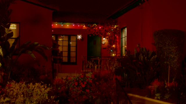 medium angle of spanish style ranch house. christmas lights visible. - ranch house stock videos & royalty-free footage
