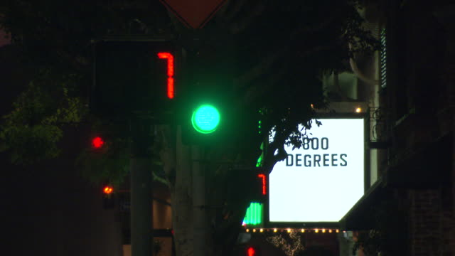medium angle of traffic signals or lights. westwood village. - westwood neighborhood los angeles stock videos & royalty-free footage