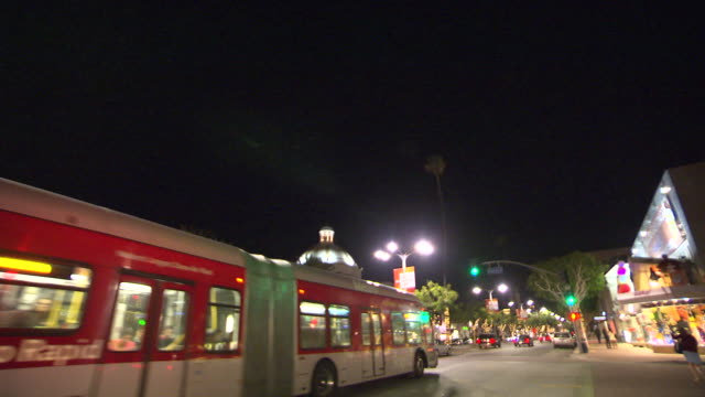 pan up from cars on city streets. westwood village. - westwood video stock e b–roll