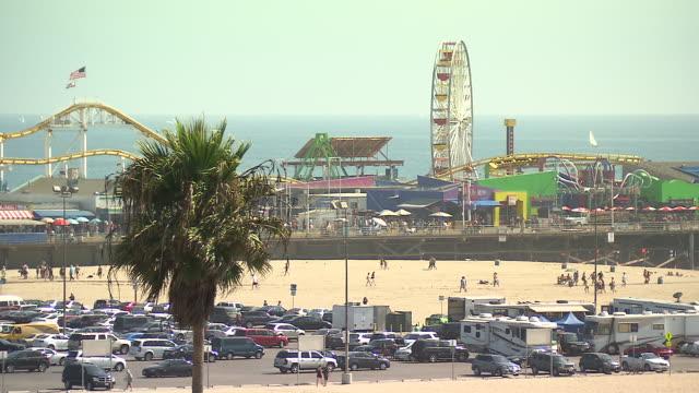 wide angle of santa monica pier amusement park. - amusement park stock videos & royalty-free footage