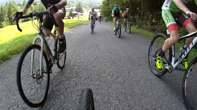 hundreds of mt bikers head up the highest peak in vermont mt mansfield to the summit camera mounted on bike - salmini stock videos and b-roll footage
