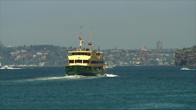 VS MANLY FERRY IN HARBOUR MOVES AWAY FROM CAM GOING TOWARDS CITY