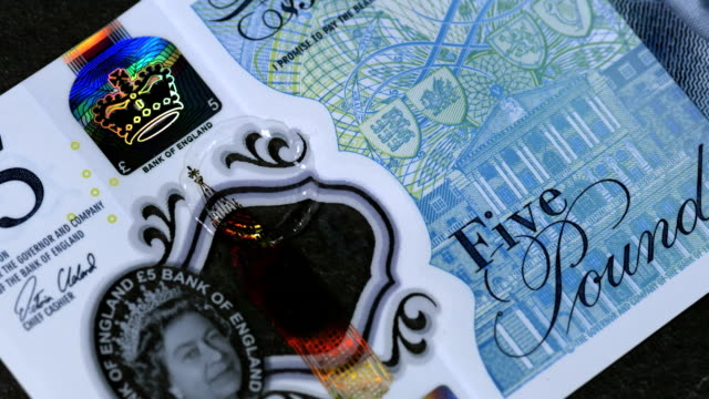 water droplets hitting the new uk waterproof £5 note in super slow motion 2000 fps hd - super slow motion stock videos & royalty-free footage