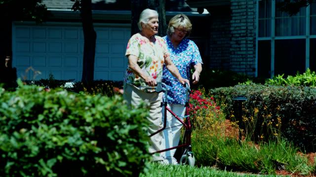 ELDERLY WOMAN WITH WHEEL WALKER