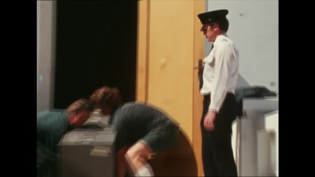 various shots removal men carry filing cabinets out of parliament house and put it in van following governor general's sacking of whitlam government... - removal man stock videos & royalty-free footage