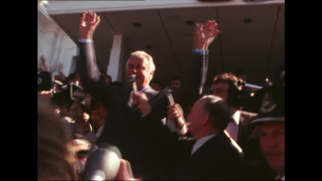 """people cheer prime minister gough whitlam on steps of parliament house / whitlam speech """" the emmisary from the governor general usually comes up... - rejection stock videos & royalty-free footage"""