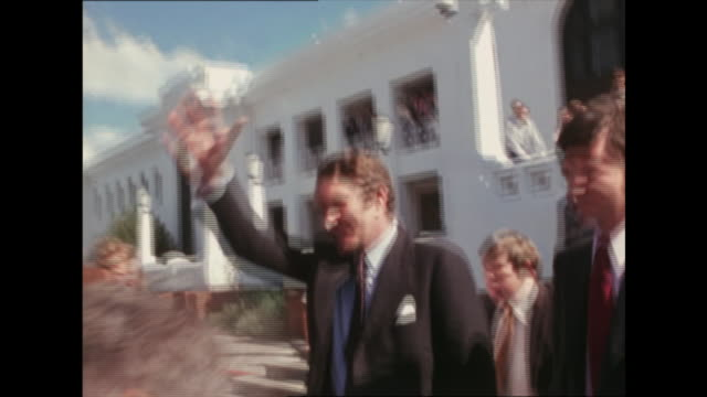 malcolm fraser is heckled as he walks from parliament house to car surrounded by press and others - journalist peter harvey tries to talk to him .... - rejection stock videos & royalty-free footage