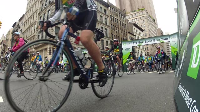 thousands head out to the streets of manhattan for the five boro bike tour - salmini stock videos and b-roll footage