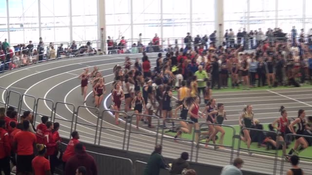 female runners on indoor track early in race, large pack, long shot - salmini stock videos & royalty-free footage