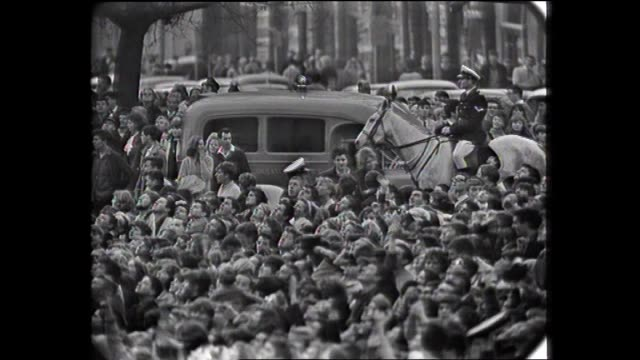 the beatles in australia various shots mass crowd on street pan to exterior southern cross hotel / vs crowd fans in trees mounted police tram passes... - hysteria stock videos & royalty-free footage