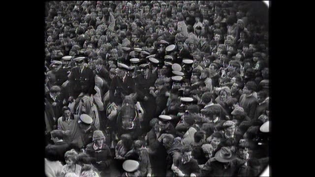 various shots huge crowd in exhibition street melbourne waiting for the beatles to arrive vs police and mounted police amongst crowd - the beatles stock videos and b-roll footage