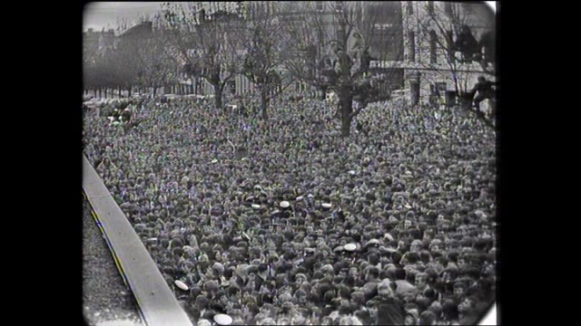 "various shots of massive crowd waiting for the beatles - girl carried away - crowd surging as hear chants of ""we want the beatles"" - 1964 stock videos & royalty-free footage"
