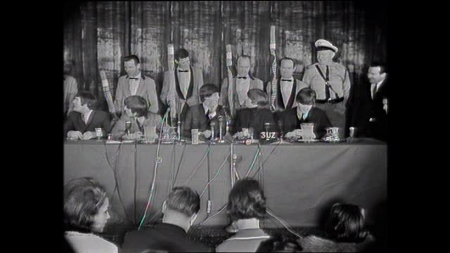 beatles presser ringo starr lights a cigarette for john lennon do you mime john that would be cheating / men in tuxedos come in and stand behind them... - ringo starr stock videos & royalty-free footage