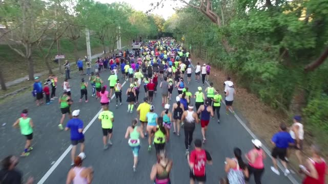 drone, running race start, drone moves out with runners - salmini stock videos & royalty-free footage
