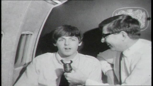 vídeos de stock, filmes e b-roll de quick shot cockpit of plane seen from behind pilots / beatles on the way to australian tour bob rogers interview with paul mccartney who is smoking... - 1964