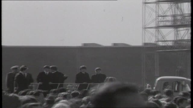 the beatles on open top truck tour sydney airport waving to crowds of fans various standing and sitting on building rooftops including airport workers - popular music tour stock videos and b-roll footage