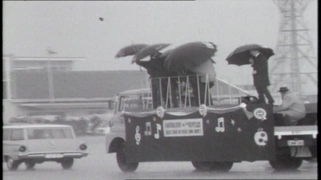 the beatles john lennon paul mccartney george harrison jimmy nicol sydney airport tarmac drive on open top platform truck - parade for fans beatles... - george harrison stock videos & royalty-free footage