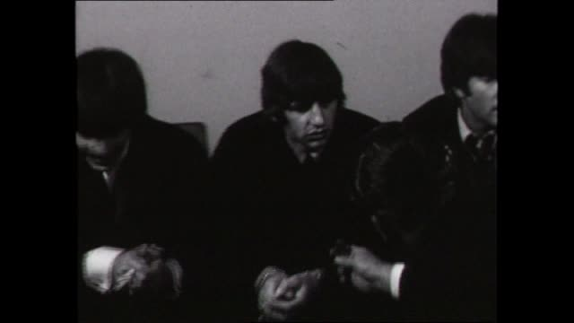 the beatles pre press conference - close up ringo puts on sunglasses / cutaway press / wide shot fab four presser zoom in to ringo starr answering... - press conference stock videos & royalty-free footage