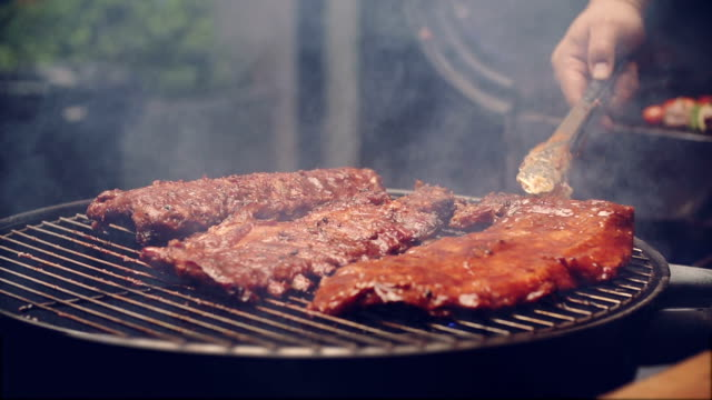 bbq ribs on grill - grilled stock videos and b-roll footage