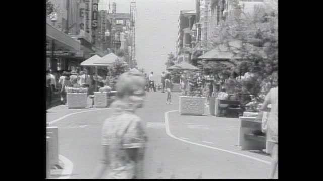 pedestrians shopping at hay street mall perth looking east / pan pensioner barracks / tracking pov from car corner of milligan wellington streets... - 1960 stock videos & royalty-free footage