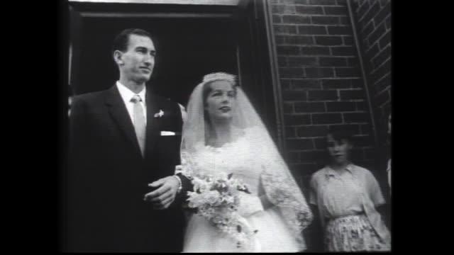 HERB ELLIOTT WEDDING/ HERB ELLIOTT BRIDE ANN DUDLEY AT THE CHURCH HOLY ROSARY CHURCH NEDLANDS / ARRIVING AND ENTERING INT CHURCH EXITING VARIOUS...